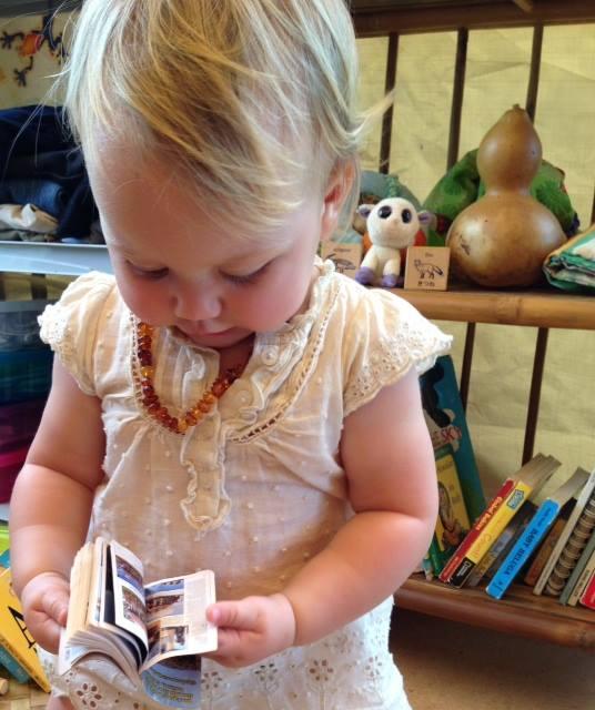 Girl reading mini book