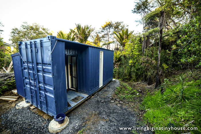 Off-the-Grid Shipping Container Tiny Home - The Shelter Blog on container home bedrooms, container home interior, cheap home designs, container home mansion, container hotels, container home layouts, container house, container home plans, 12 foot house designs, container home videos, wooden house designs, yurts designs, barn home designs, mobile home designs, container home blueprints, container home roof, container home info, pallet home designs, container home siding, small home designs,