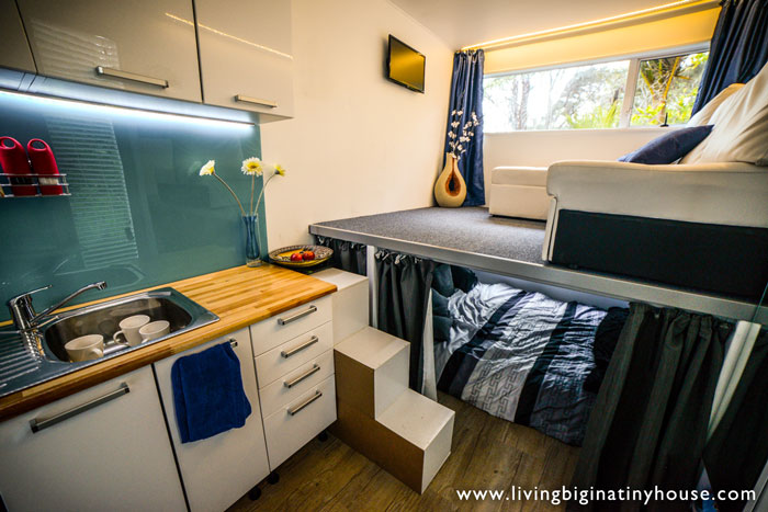 Off the grid shipping container tiny home the shelter blog for Interior design room grid