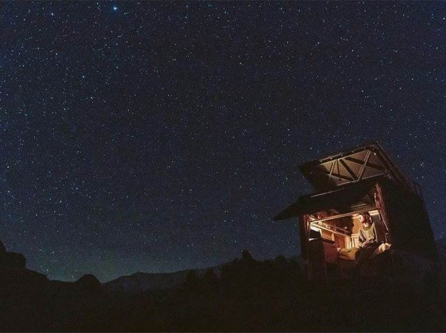 """@dreamweaverscollective crafted this """"cedar cabin on wheels"""", 42 sq ft interior, features a wood burning Dickinson stove, kitchen cabinet w/ a stowed away cook stove + dishes and bed for 2 among other amenities. The top pops up for fresh air and stargazing"""